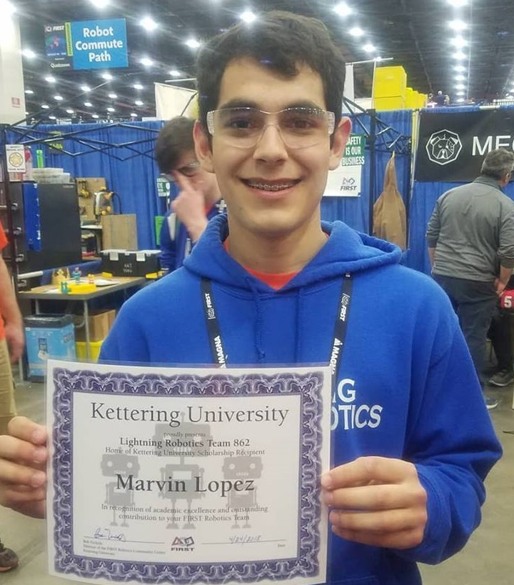 Marvin Lopez holding Kettering scholarship