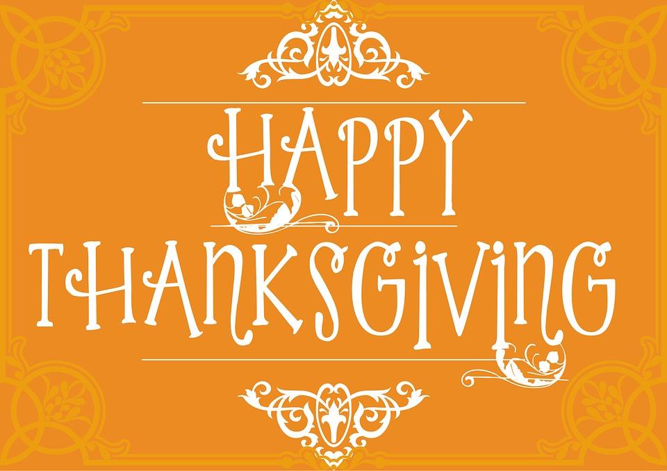 words happy thanksgiving on orange background
