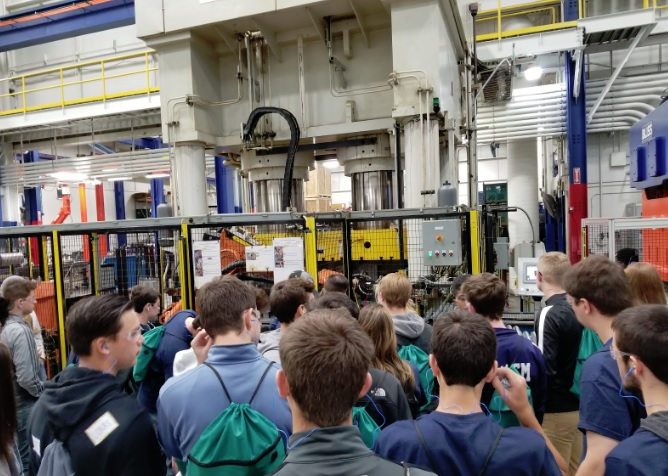 students touring factory