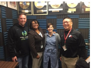 Merritt with 3 guests in radio studio