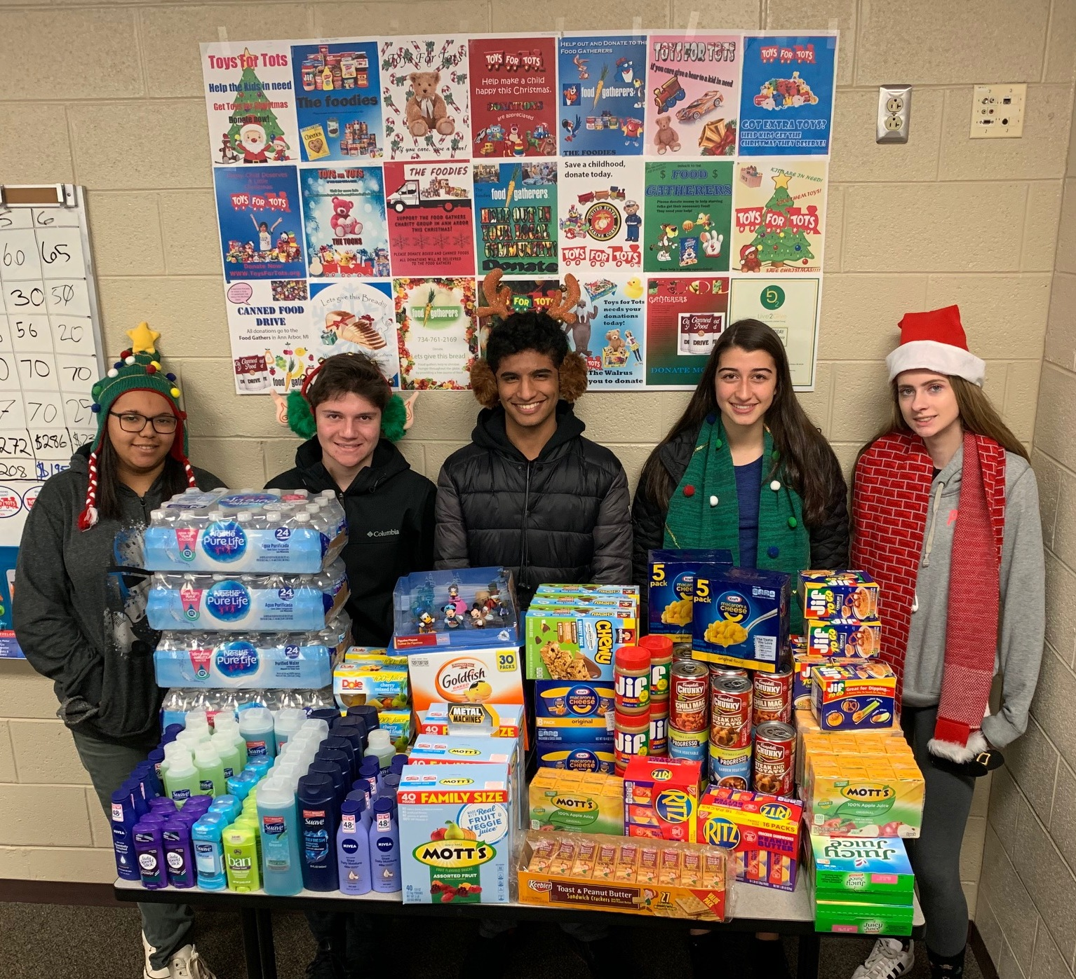 students with collected food for local charity