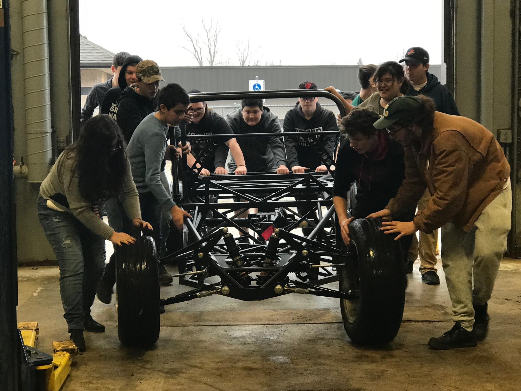 students with chassis