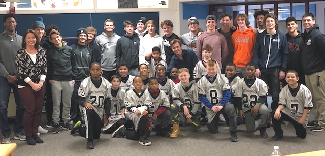 high school football players and elementary students